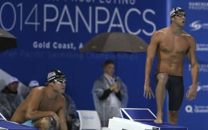 Michael Phelps of the U.S., right, and teammate Nathan Adrian prepare for their men's 100m freestyle final at the Pan Pacific swimming championships in Gold Coast, Australia, Friday, Aug. 22, 2014. Cameron McEvoy of Australia won the race ahead of Nathan Adrian in second and James Magnussen of Australia in third. (AP Photo/Rick Rycroft)