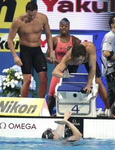 The United States mixed 4x100m freestyle relay team from left, Ryan Lochte, Simone Manuel, Nathan Adrian and Missy Franklin, bottom, celebrate after winning the gold medal at the World Championships in Kazan, Russia, Saturday. (AP Photo/Michael Sohn)