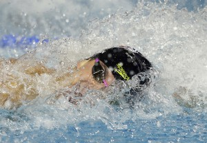 Nathan Adrian swims in the 100-meter freestyle during the Duel in the Pool swim meet Friday, Dec. 11, 2015, in Indianapolis. Adrian won the event. (AP Photo/Darron Cummings)