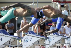 From left; Anthony Ervin and Nathan Adrian compete in the 50-meter freestyle final during the Arena Pro Swim Series swim meet, Friday, April 15, 2016, in Mesa, Ariz. (AP Photo/Matt York)
