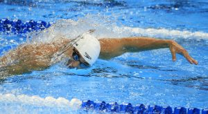 Nathan Adrian swims in the men's 100-meter freestyle preliminaries at the U.S. Olympic swimming trials, Wednesday in Omaha, Neb. (AP Photo/Orlin Wagner)