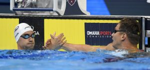 Anthony Ervin reacts with Nathan Adrian, right, after their heat in the men's 50-meter freestyle semifinal at the U.S. Olympic swimming trials, Friday, July 1, 2016, in Omaha, Neb. (AP Photo/Mark J. Terrill)