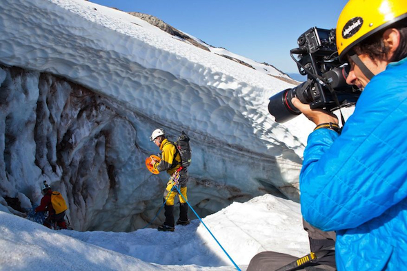 "In this 2013 photo from Oregon Public Broadcasting, photographer Andy Maser, right, photographs cavers in the Mount Hood Wilderness area in Oregon for an episode of ""Oregon Field Guide."""