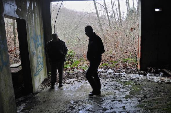 Park staff wander the property's concrete storage building.