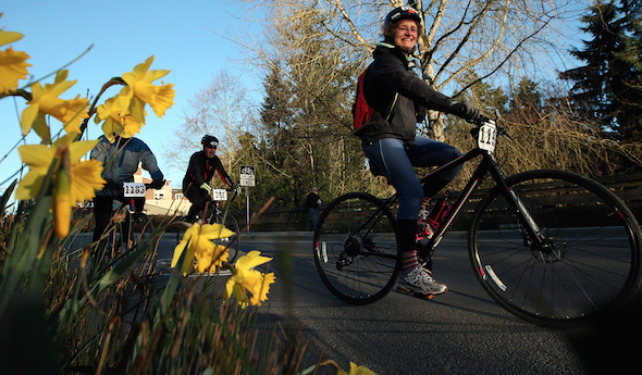 Cyclists pedal along Winslow Way during Bainbridge's 2015 Chilly Hilly ride. Meegan M. Reid/Kitsap Sun