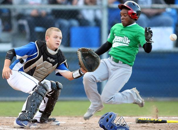 Greenville's Cameron Andrews slides into home base ahead of the catch by Bryant's Garrett Misenheimer during their championship game at Gene Lobe field on August 22, 2012. (MEEGAN M. REID / KITSAP SUN)