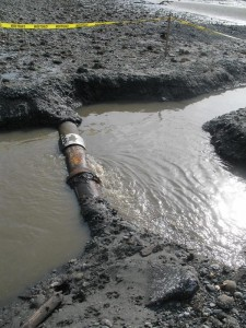 <i>Before final repairs, a temporary band slowed the flow of sewage</i><br><small Kitsap Sun photo by Tristan Baurick</small>