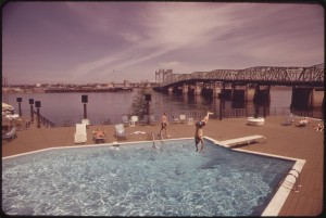 Photographer David Falconer captures visitors swimming in the pool at the Thunderbird Motel alongside the I-5 Bridge on the Columbia River, May 1973. EPA photo