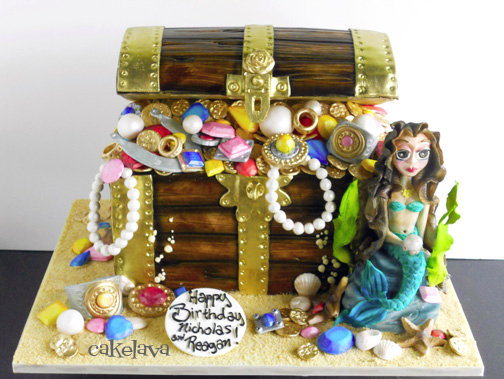 A pirate theme is combined with a mermaid theme in this cake for two children, a brother and a sister, who celebrate their birthdays together. All the jewels in the chest are edible.