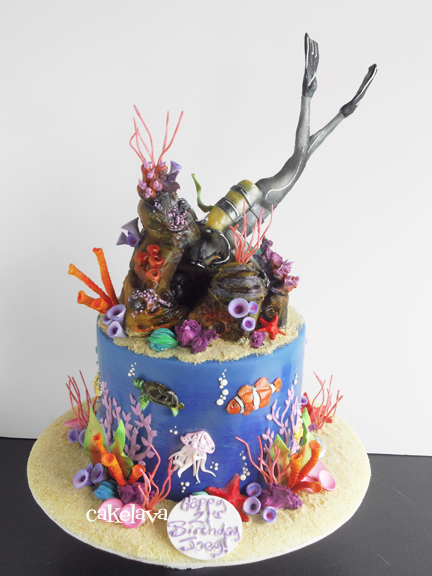 This scuba diver cake, a recent creation, was made to celebrate the 21st birthday of a marine biology major who enjoys diving.