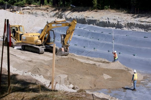 Last summer, a massive pond was constructed off Waaga Way to capture stormwater from developments that was flowing into Steele Creek. Photo by Larry Steagall