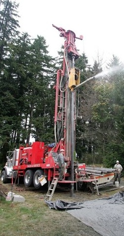 Craig Greshman of Gresham Well Drilling drills a new well on Virginia Point in Poulsbo. Kitsap Sun photo by Larry Steagall