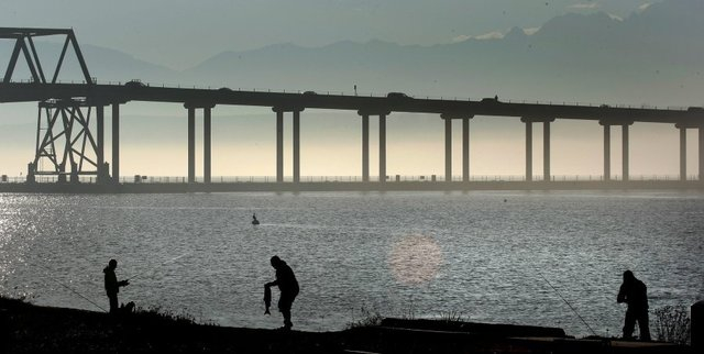Fishermen fish for salmon north of the Hood Canal bridge, but researchers say the bridge may be an obstacle to the migration of young steelhead. Kitsap Sun photo by Larry Steagall