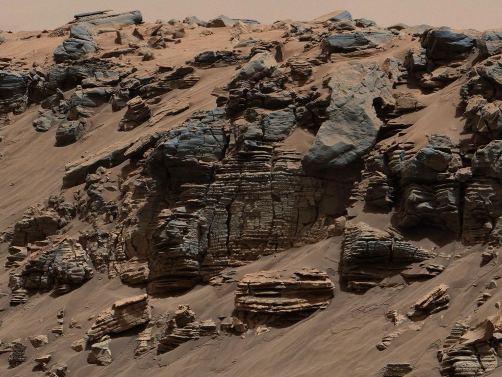 Notice the layers in rock photographed by Curiosity, NASA's Mars rover. The formation leads scientists to believe the formation was formed by a series of sedimentary deposits laid down over millions of years. The color was white-balanced to approximate how the scene would look under daytime lighting conditions on Earth. Photo courtesy of NASA/Jet Propulsion Laboratory