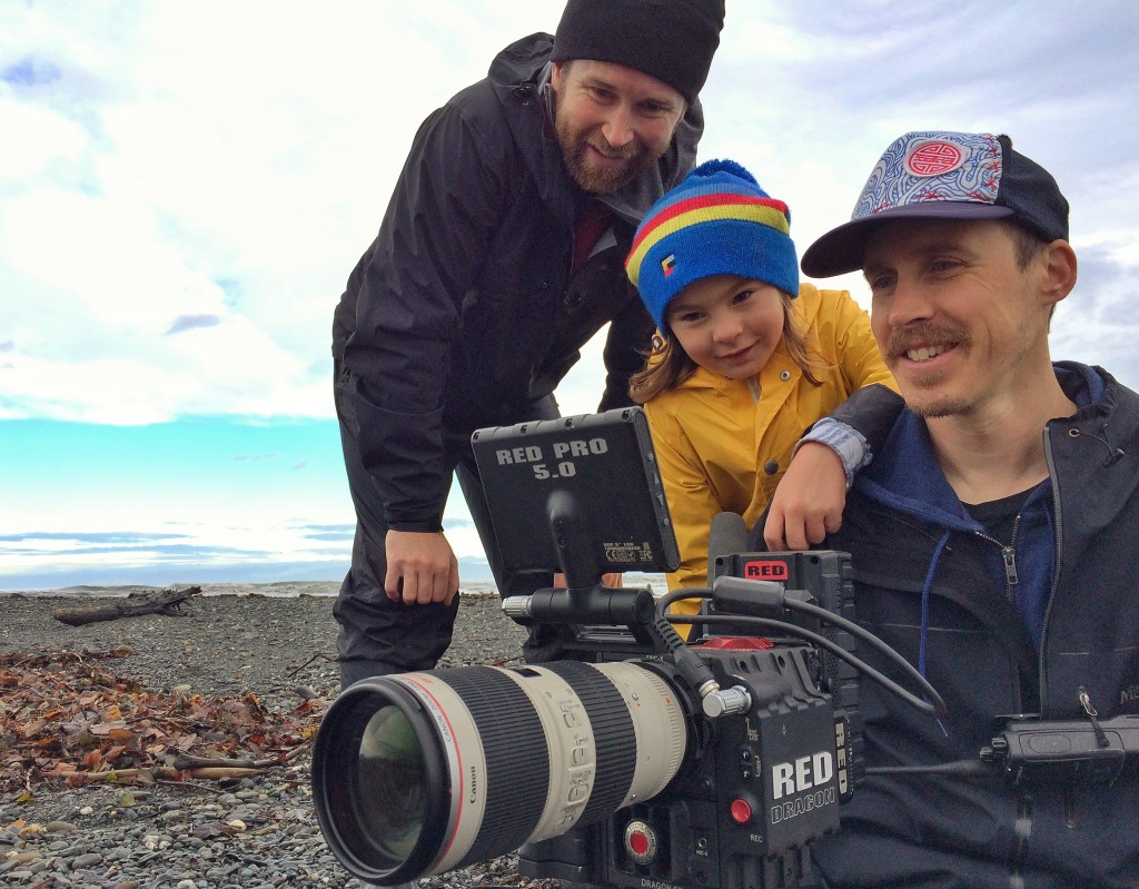 Hayden Peters, left, Parker Arneson and Skip Armstrong review footage shot at the Elwha River delta.