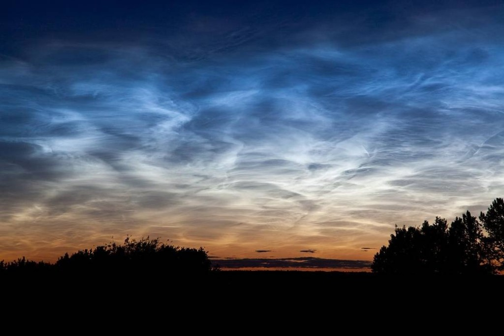 A notilucent cloud photographed on July 2, 2011, near Edmonton, Alberta, Canada. Photo: NASA/Dave Hughes