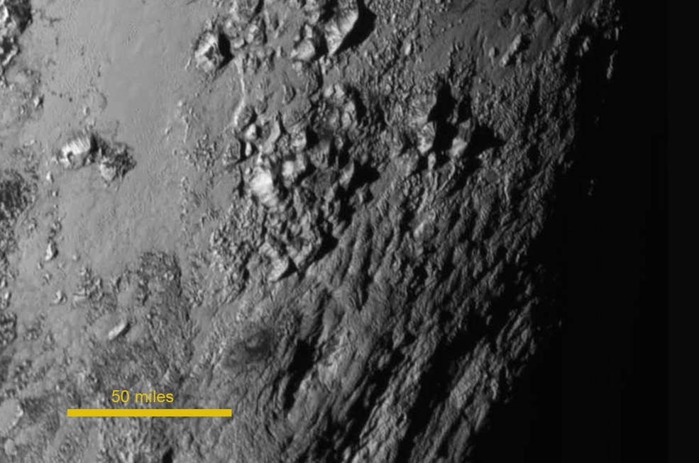 This image of mountains was taken by New Horizons just 1.5 hours before the spacecraft's closest approach to Pluto. Image Credit: NASA-JHUAPL-SwRI