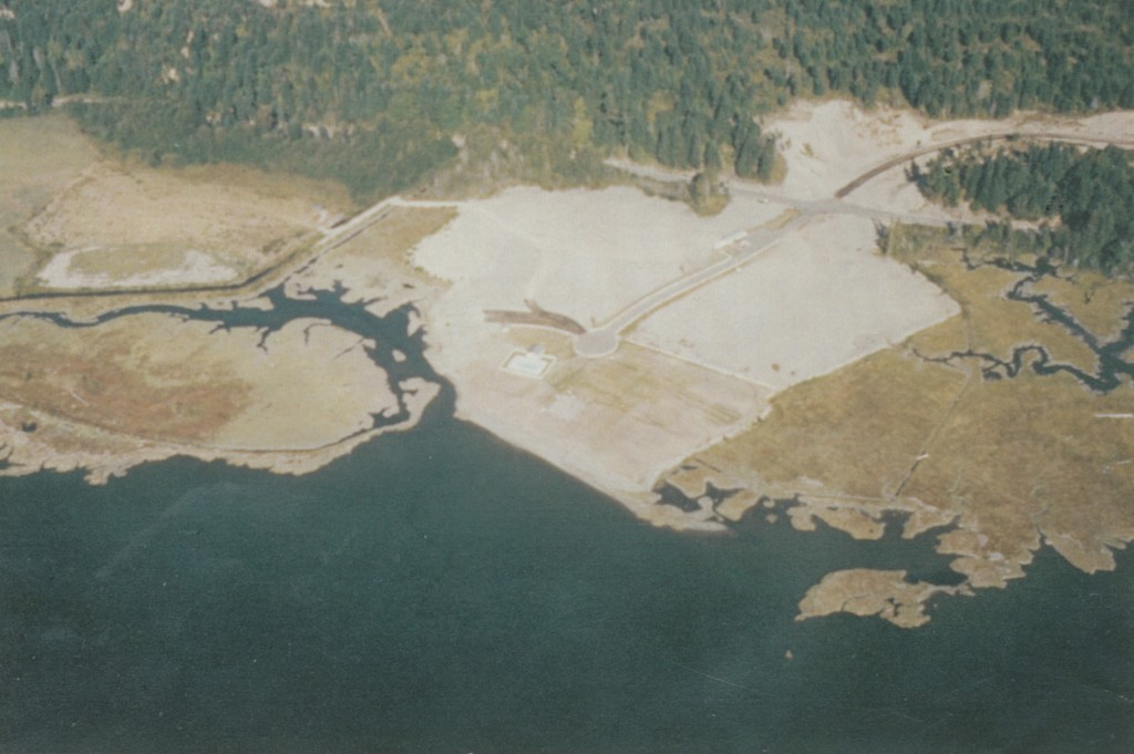 Aerial photo from 1973 during construction of the Beard's Cove development, a portion of which was built on fill going out into Hood Canal. Image: Beard's Cove restoration file.