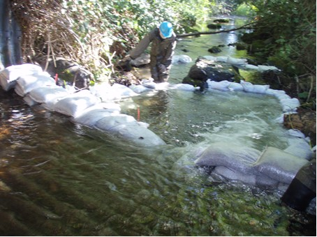 Temporary step pools at a culvert on Salmon Creek enable salmon to go upstream. Photo: