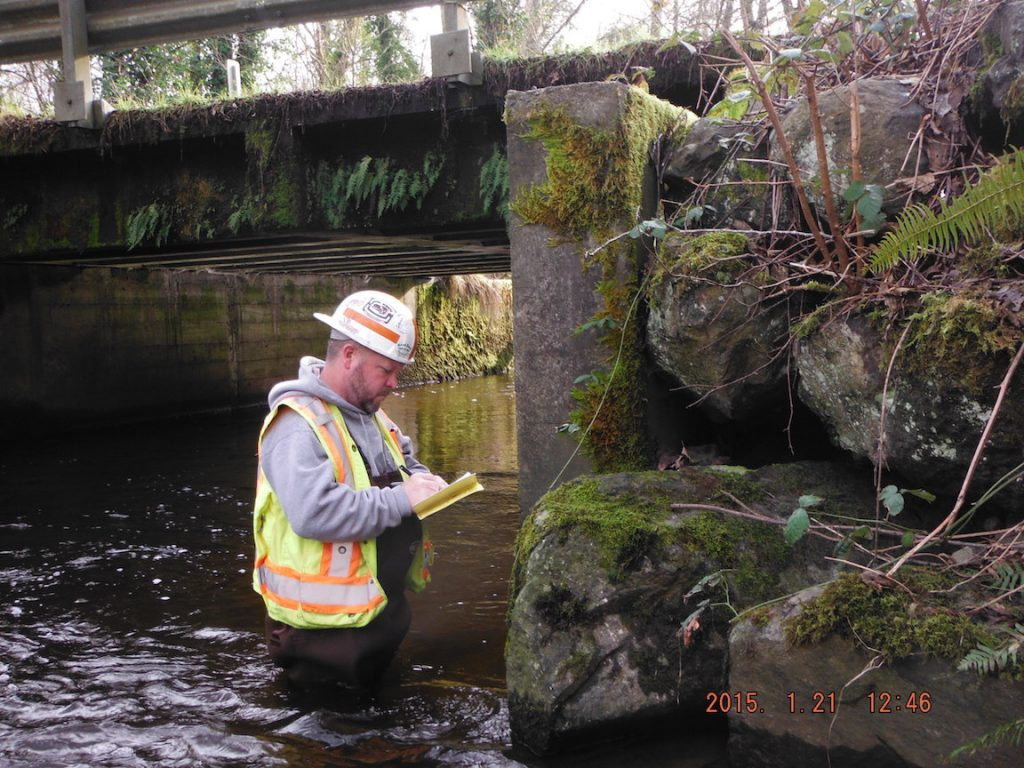 Dan Wolfe of Kitsap County Public Works conducts an annual inspection of the Spruce Road Bridge over Burley Creek. Photo: KC Public Works