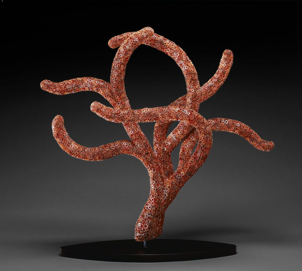 """Red Polyp"" blown glass with mixed hollow murrine woven with copper wire by Kait Rhoads. This piece is 45 by 49 by 19 inches. Photo: Kait Rhoads"