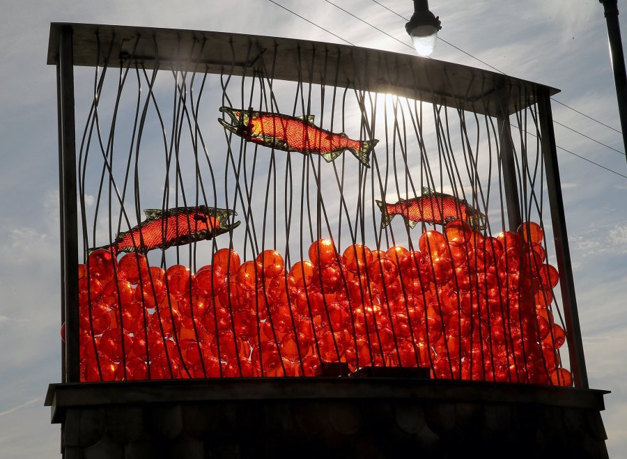 Salmon and more than 200 glass eggs are part of a sculpture that makes up a new kiosk at the east end of the Bucklin Hill Bridge. Photo: